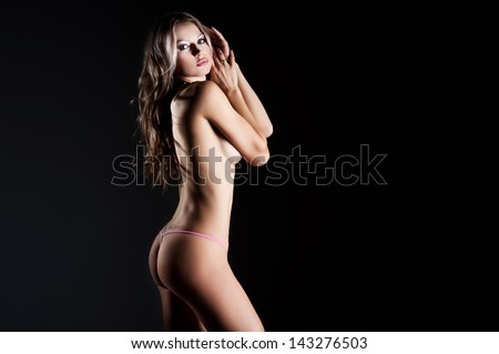 The beautiful blonde with a slim figure - stock photo