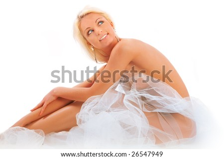 The beautiful blonde with a veil on a white background - stock photo