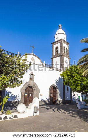 The beautiful church of San Gines in Arrecife with its white-washed exterior and attractive bell tower - stock photo