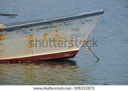 The beautiful classic lines of an old Maine Skiff in need of some TLC - stock photo