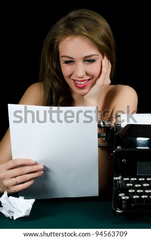 The beautiful girl at a typewriter. Retro - stock photo