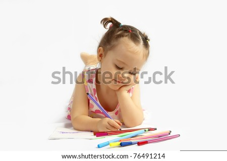 The beautiful girl drawing pencils in a sketch pad on the isolated white background - stock photo