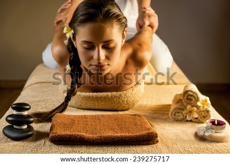 The beautiful girl has massage. Stretching. - stock photo