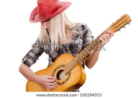 The beautiful girl in a cowboy's hat whith acoustic guitar - stock photo