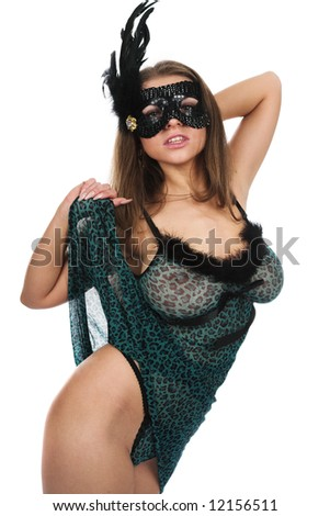 The beautiful girl in a mask - stock photo