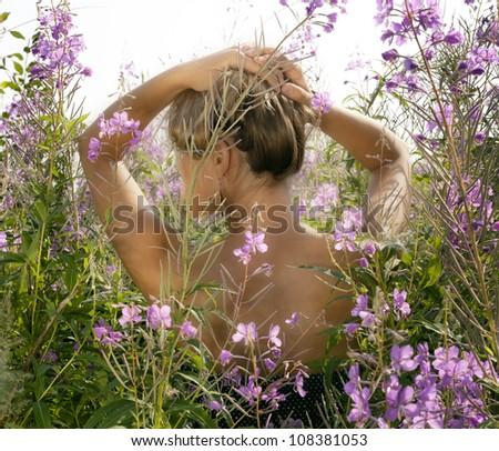The beautiful girl in wild flowers. - stock photo