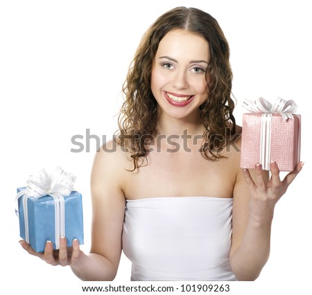 The beautiful girl smiling holds a gift in a boxes on a white background. - stock photo