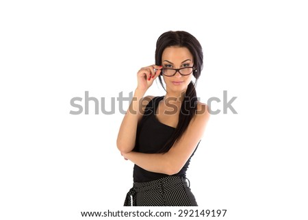 The beautiful girl wearing spectacles on a white background - stock photo