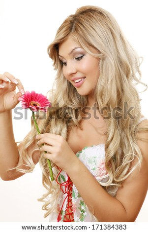 The beautiful girl with a flower  - stock photo