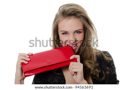 The beautiful girl with a red handbag - stock photo