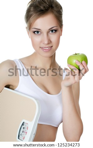 The beautiful girl with apple in hand - stock photo