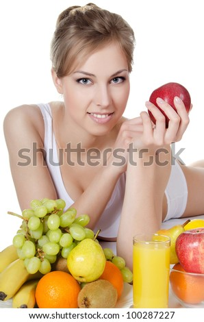 The beautiful girl with fruit and vegetables - stock photo