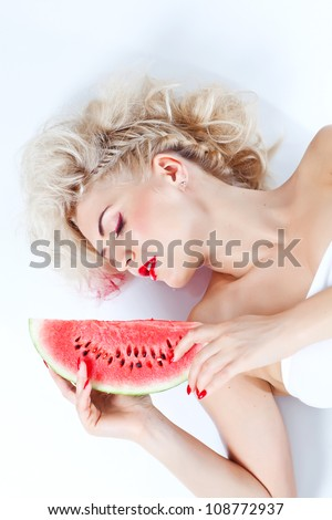 The beautiful girl with water-melons - stock photo
