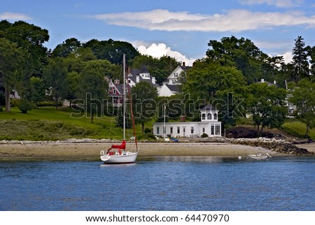The beautiful house at a seaside and a yacht - stock photo