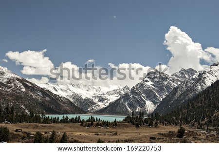 the beautiful lake under the snow mountain?blue sky with white cloud. - stock photo