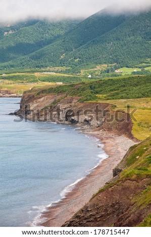 The beautiful landscape of Cape Breton Island, Nova Scotia where ocean and mountains meet. - stock photo