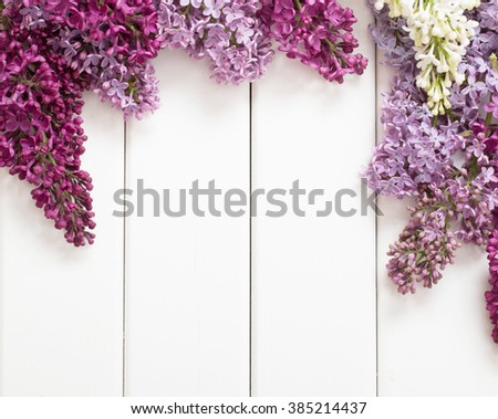 The beautiful lilac on a wooden background - stock photo