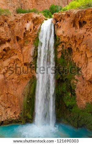 The beautiful Mooney Falls in the Grand Canyon near the Havasu area - stock photo