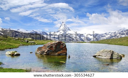The beautiful mountain landscape with Stellisee lake. Switzerland. - stock photo