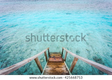 The beautiful ocean views form staircase Maldives water villa , View from runway the indian ocean bay, beach pier for jumping, fishing and snorkeling, Maldives islands - stock photo