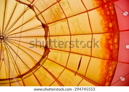 The beautiful pattern inside a hot air balloon. - stock photo