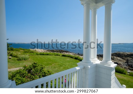 The beautiful porch and columns of the Marshall Point Lighthouse keepers quarters - stock photo