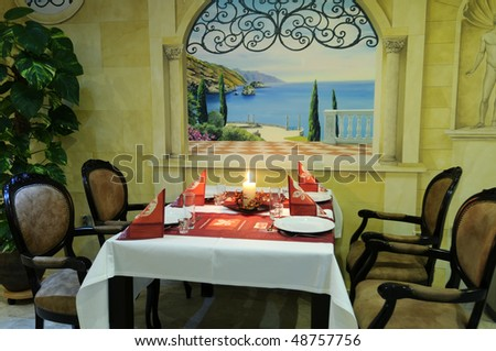 The beautiful romantic dining room with served table ready for guests. - stock photo