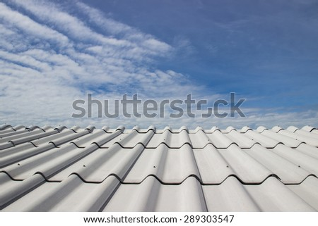 the beautiful roof of house and blue sky background - stock photo