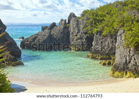 The beautiful secluded romantic Jobson Cove Beach on the south side of Bermuda. - stock photo