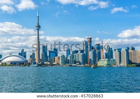 The beautiful Toronto's skyline over Lake Ontario. Urban architecture. Ontario, Canada. - stock photo