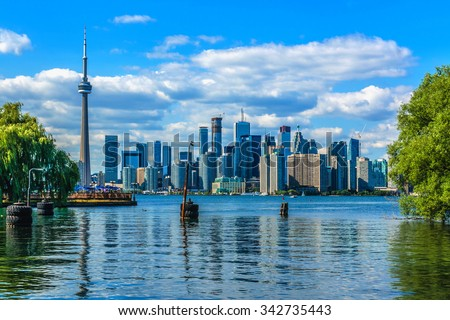 The beautiful Toronto's skyline over lake. Toronto, Ontario, Canada. - stock photo