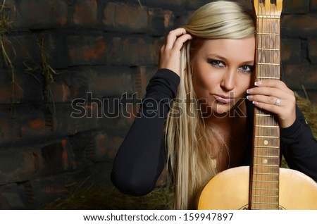 The beautiful woman in shed a wall - stock photo