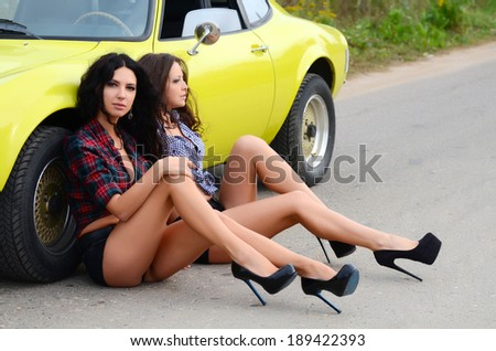 The beautiful woman with yellow retro car - stock photo
