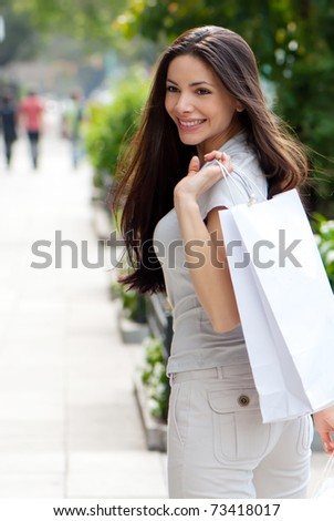 The beautiful young girl with a shopping Bag - stock photo