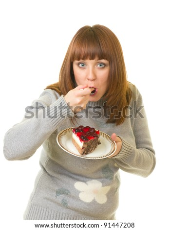 The beautiful young woman eat tasty cake on white background. - stock photo