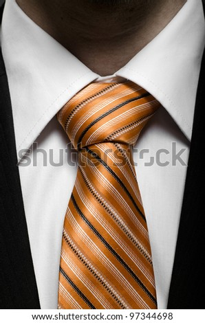 the beauty black business  costume with orange necktie, close up - stock photo