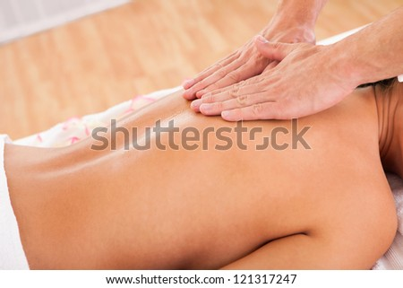 The beauty of experienced hands working through customer's back - stock photo