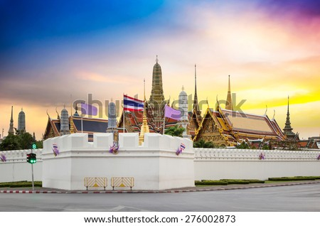 The beauty of the Emerald Buddha Temple. And while the gold of the temple catching the light. This is an important buddhist temple of thailand and a famous tourist destination. - stock photo