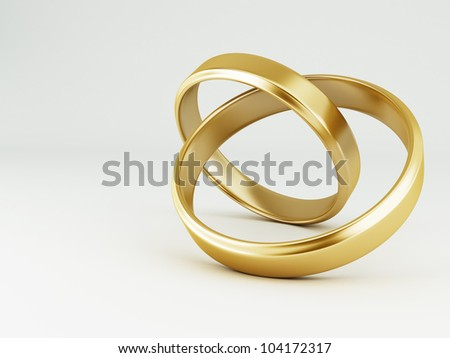 The beauty wedding gold rings on white background - stock photo