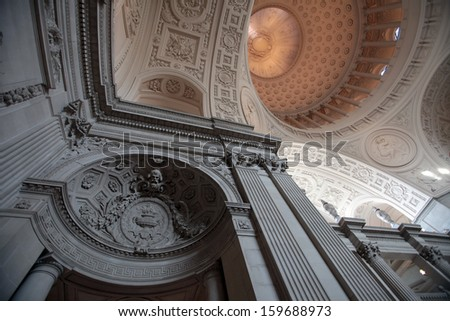 The Beaux-Art style of San Francisco's City Hall creates a magnificent interior to the active municipal building in the city's Civic Center. - stock photo