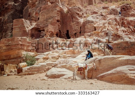 The beduin with donkey at the ancient site of Petra, Jordan - stock photo