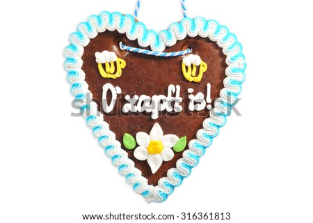The beer is tapped - original bavarian Oktoberfest gingerbread heart from Germany on white background - stock photo