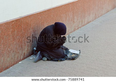 The beggar asks for alms on the street - stock photo