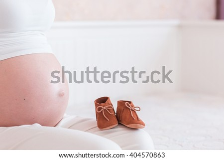 the belly of young pregnant woman - stock photo
