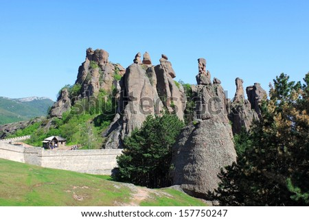 The Belogradchik Rocks are a group of rock formations with bizarre shapes. They are situated in the Balkan Mountains near the town of Belogradchik in Bulgaria and are a famous tourist destination. - stock photo