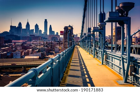 The Ben Franklin Bridge Walkway and skyline, in Philadelphia, Pennsylvania. - stock photo