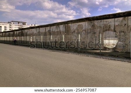 The Berlin Wall (Berliner Mauer) in Germany. Hole in the wall, barrier constructed in 1961, that completely cut off West Berlin from East Berlin, demolished in 1989. - stock photo