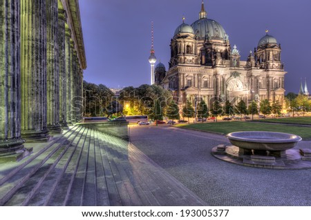 The Berliner Dom and television tower from the steps of the Altes Museum on Museum Island. - stock photo