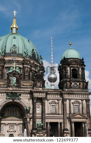 The Berliner Dom is a popular tourist destination in the heart of Berlin and television tower in Berlin. - stock photo