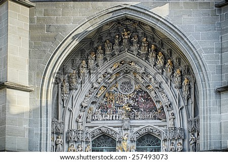 The Bern Minster cathedral shows the Last Judgment over the main entrance. The wicked are naked on the right, while the righteous are clothed in white on the left. In the center is Justice. - stock photo